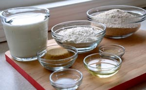 water, sugar, and yeast mixture into the flour.